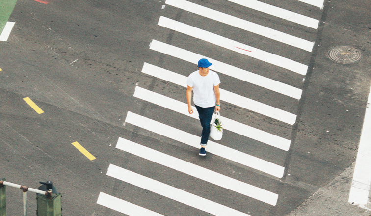 Man walking across crosswalk
