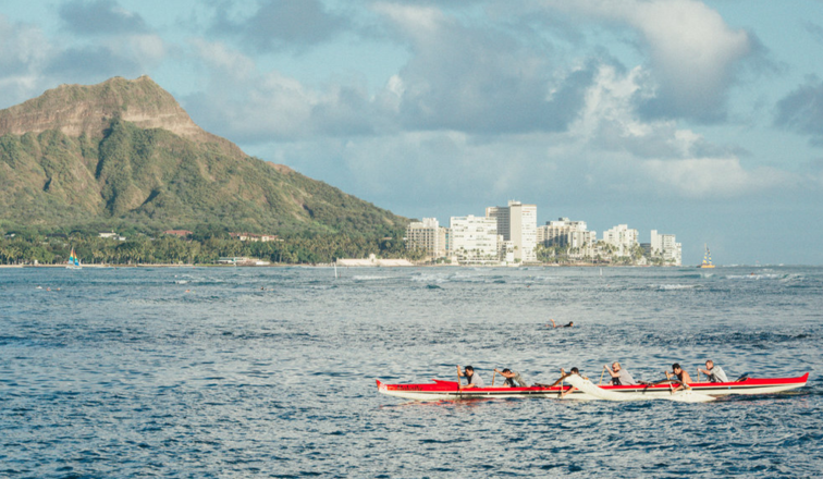 Team paddling an outrigger together