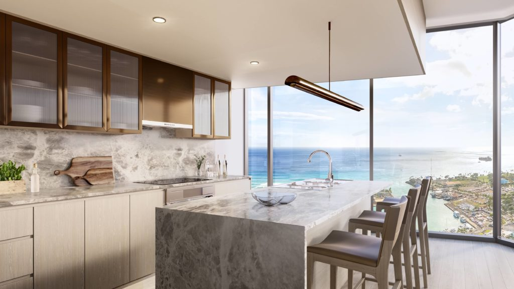 Corner kitchen with neutral countertops and cabinetry and an ocean view