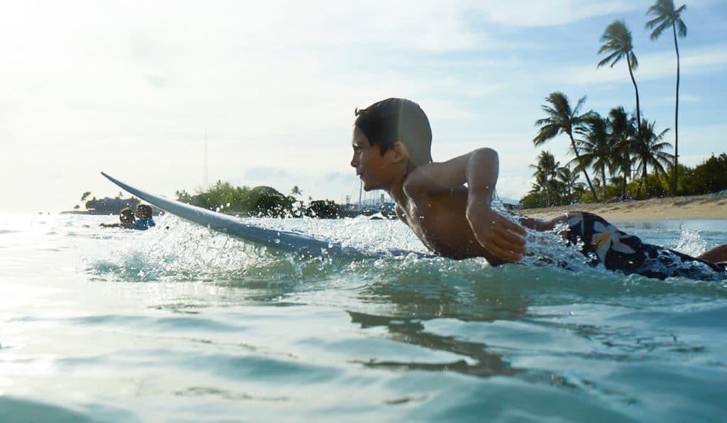 A boy on a surf board
